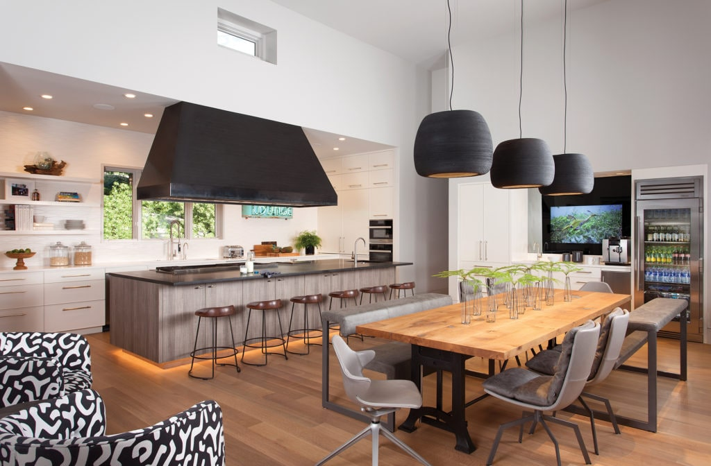 The large kitchen and breakfast area includes a walk-in refrigerator, similar to those typically used in restaurants.