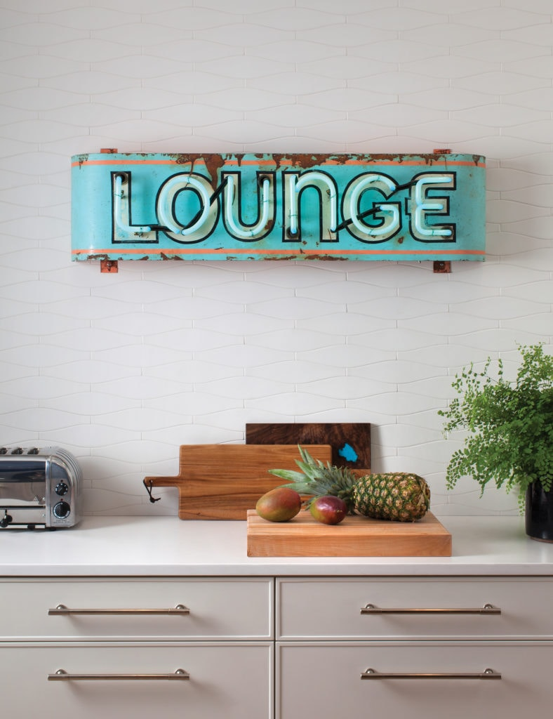 The neon LOUNGE sign sets the tone for the fun-loving vibe of Rypka's home.