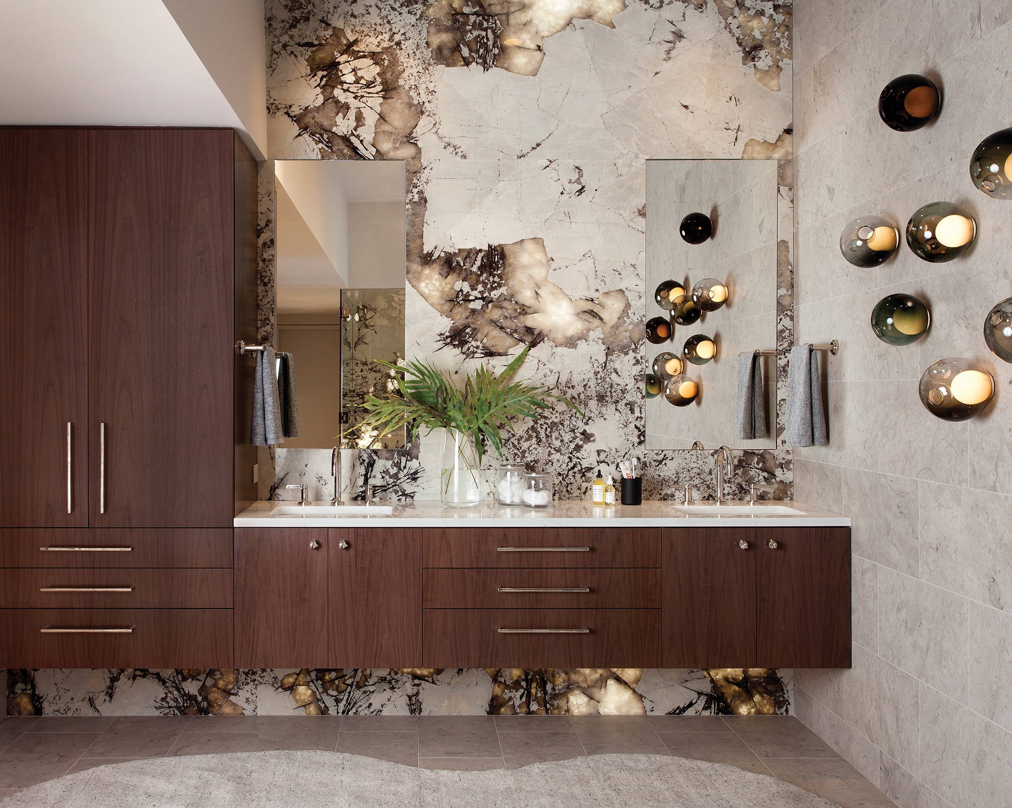 The owner's bathroom suite features a backlit glowing stone wall.