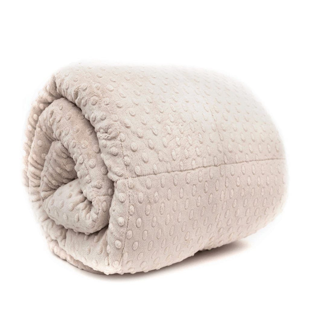 Get restful sleep with the help of a weighted blanket. Mosaic Weighted Blankets Latte Minky Weighted Blanket ($129.95) at mosaicweightedblankets.com
